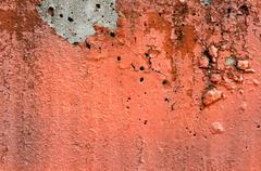 orange black white painted chappy wall texture background. - stock photo