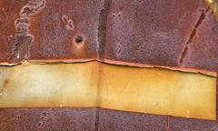 Rusty red yellow sheet of metal plate. Stock Photos