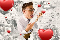 Composite image of geeky businessman licking his keyboard - stock photo