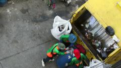 Municipal workers collect garbage Stock Footage