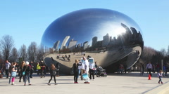 Cloud Gate sculpture with tourists in Millenium park - stock footage