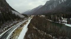 Aerial Stock Footage Flight over the Mountain Road Along the River in Winter Stock Footage
