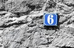House number six on the blue board. Stock Photos