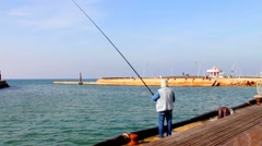 Old fisherman in the old port in the southern Mediterranean  sea Stock Footage