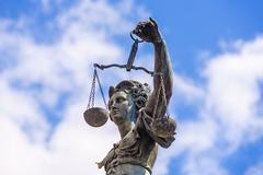 statue of lady justice in front of the romer in frankfurt - stock photo