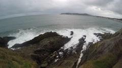 4K scenic view of white water rolling in, breaking to water, dark black rocks Stock Footage