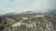 HD Aerial Footage Flying Above Mountain Farm Field in Winter Fog Stock Footage