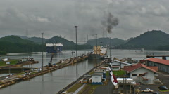 Panama Canal, total shot of two ships at miraflores locks Stock Footage