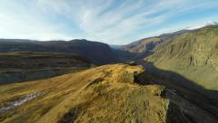 HD Aerial Footage Flying Close to the Rock in Mountain Gorge in Autumn Stock Footage