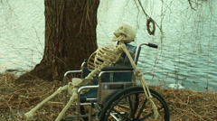 skeleton man in wheelchair creepy 1 - stock footage