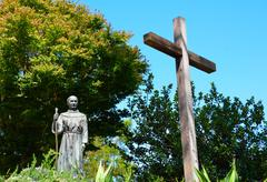 Priest and cross statue Stock Photos