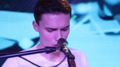 rock concert - vocalist sings his part (close-up, front view) - stock footage