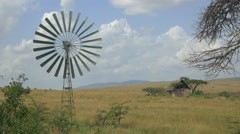 Old windmill spinning in Africa Stock Footage