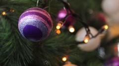 A purple christmas tree ball on a Christmas tree Stock Footage