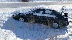 Snow Covered Car in Ditch by Highway, Open Trunk Stock Footage