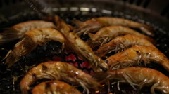Asian BBQ Grilling Fresh shrimp on a gas grill in one restaurant chinese-Dan Stock Footage