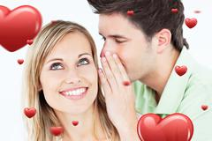 Composite image of young man whispering something to his attentive female friend - stock photo