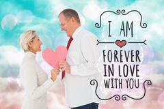 Composite image of older affectionate couple holding pink heart shape - stock illustration