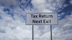 Sign Tax Return Next Exit Clouds Timelapse Stock Footage