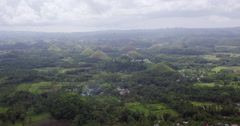 Aerial of Chocolate Hills with town in front Stock Footage