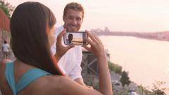 Woman taking picture of boyfriend with smart phone - Couple in love dating - stock footage