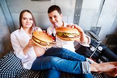 happy pregnant family eating fast food - stock photo