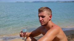 Sexy Caucasian Fit Man Drinking Water on the Beach. Slow Motion. Stock Footage