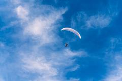 powered paragliding against the blue sky - stock photo