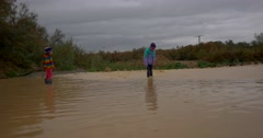Kids in a  flood  mud  river Stock Footage