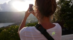 Woman Taking Photos with Mobile Phone at Sunset Stock Footage