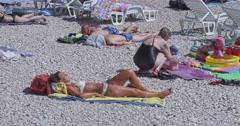 4K Primosten sunbathing on the beach Stock Footage