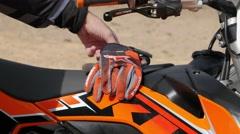 Motocross driver wear gloves 4K Stock Footage