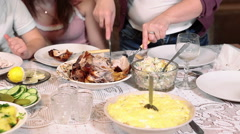 Woman carving the turkey for husband who sitting the table - stock footage
