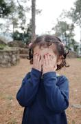 Cute little indian girl playing hide and seek. Stock Photos