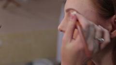 Visagiste makes makeup for  model, professional makeup - stock footage