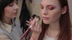 Visagiste makes makeup for  model, professional makeup, - stock footage
