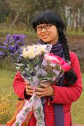 Happy woman when receiving bouquets of flowers Stock Photos