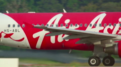 AirAsia Airbus 320 taxiing on Nov.28, International Phuket Airport, Thailand Stock Footage