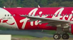 AirAsia Airbus 320 taxiing on Nov.28, International Phuket Airport, Thailand - stock footage