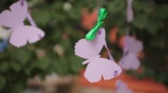 Hanging  paper butterflies outdoor Stock Footage
