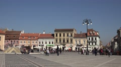 ULTRA HD 4K Tourist people enjoy Sfatului Square Brasov medieval city sunny day  Stock Footage