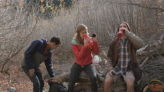 Group of frends rest while hiking Stock Footage