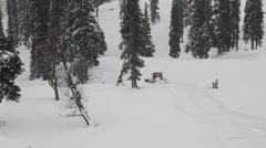 Gulmarg snowcat moves down Stock Footage
