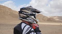 Motocross driver wear helmet 4K Stock Footage