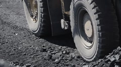 Panorama of dump truck from wheels up to dump-body and loading coal Stock Footage