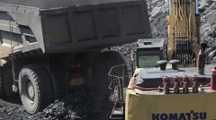 Coal mining and loading dump truck by hydraulic excavator in open pit Stock Footage