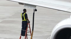 Staff adds fuel to aircraft Stock Footage