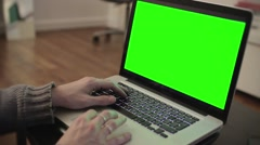 Computer green screen typing hands living room - 1080p - stock footage