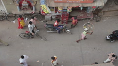 Stock Video Footage of India Puri Small street traffic High-angle shot