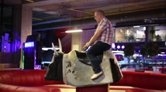 A man riding a bull Stock Footage